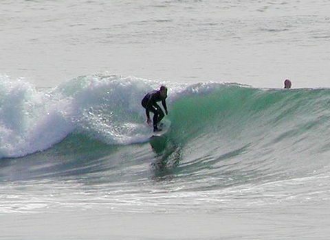 surfing on shoaling and breaking waves