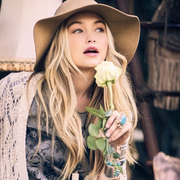 gigi hadid with flower wearing hat