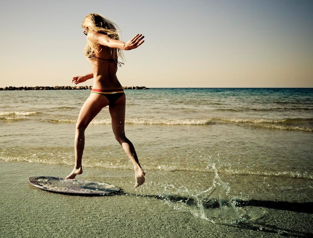 skim-boarding-girl-tel-aviv-beach