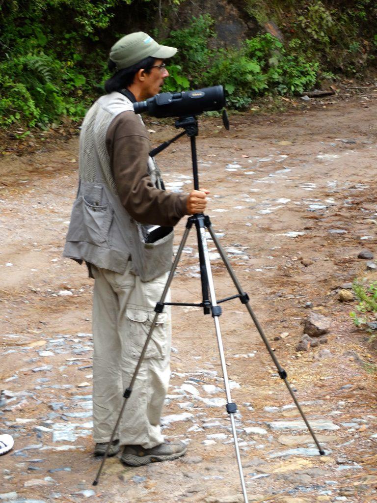 Luis Morales with birding scopes