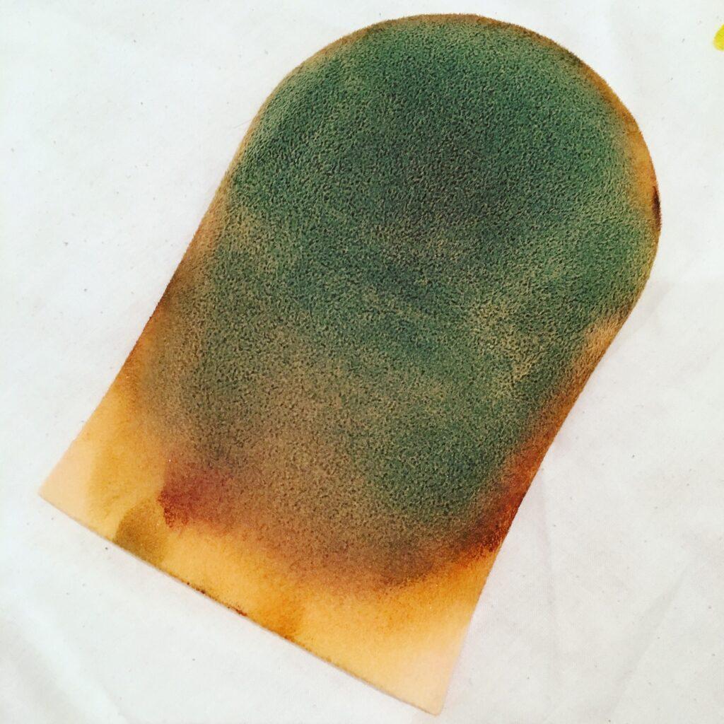 green tanning mitt
